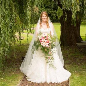 Large trailing bridal bouquet pink peach green foliage by Passion for Flowers Stanbrook Abbey wedding