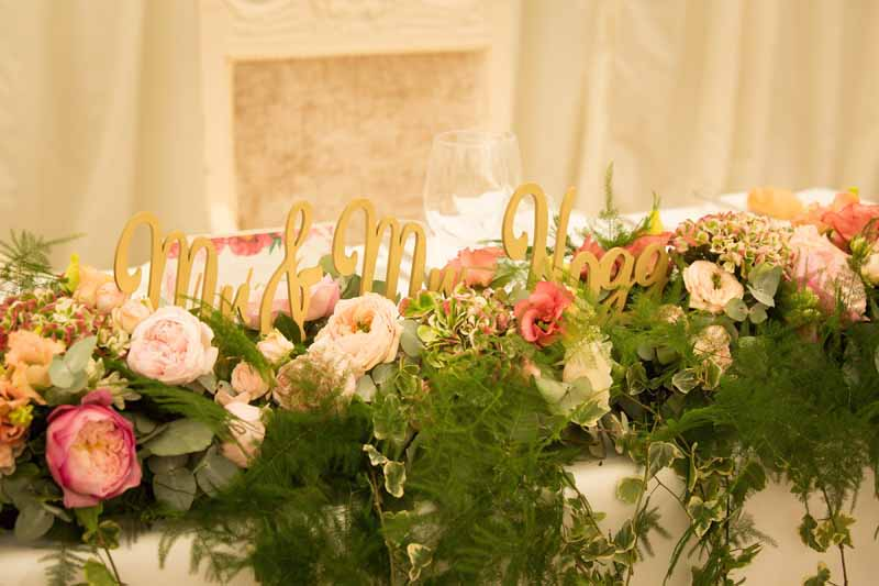 Lush top table wedding flowers marquee wedding by Passion for Flowers pink peach green