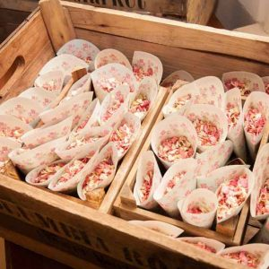 Pink confetti in cones in wooden crates