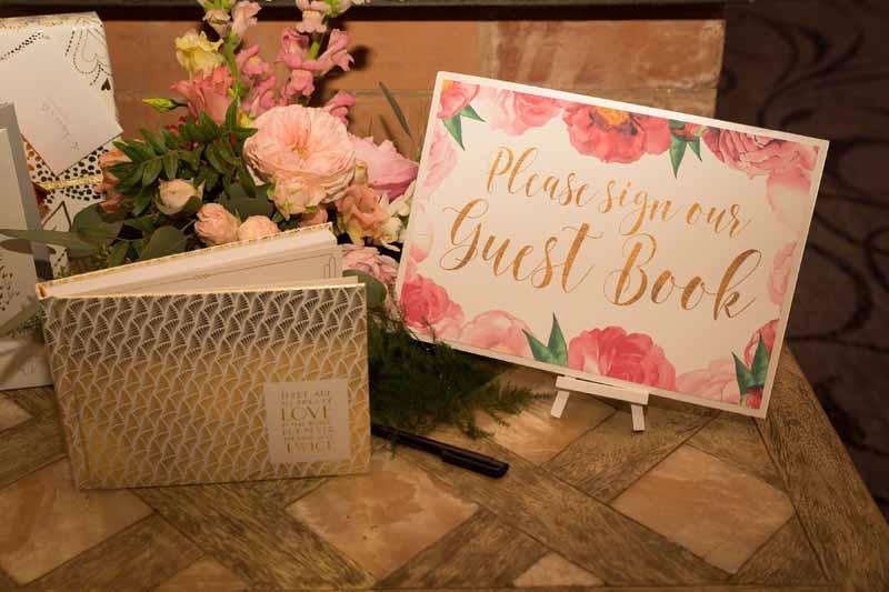 Pink floral wedding guest book sign