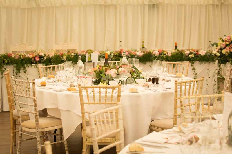Top table wedding flowers pink peach green