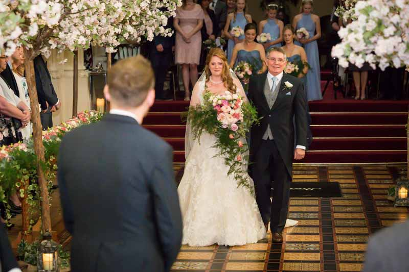 Trees down the aisle Stanbrook Abbey epic wedding ceremony