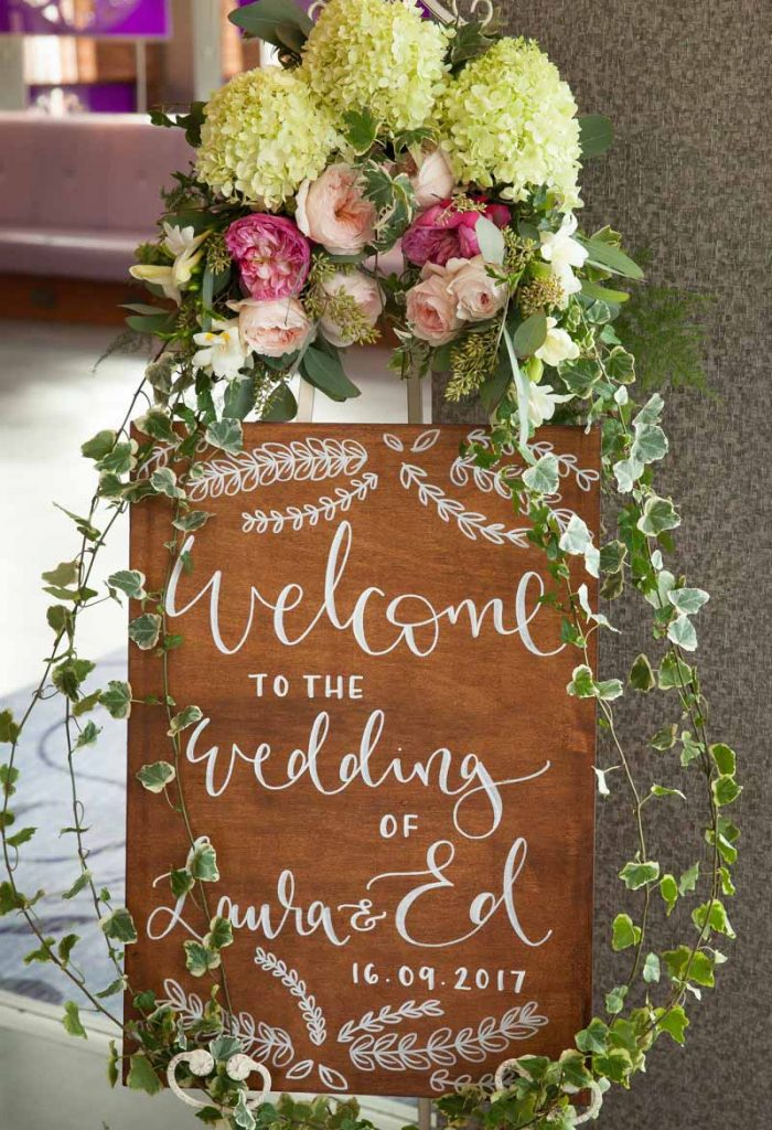 Wooden wedding welcome sign flowers trailing Passion for Flowers