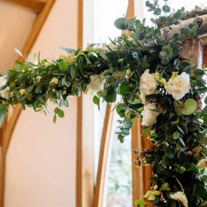 Birch-Arch-with-foliage-and-white-flowers-rustic-wedding-ceremony