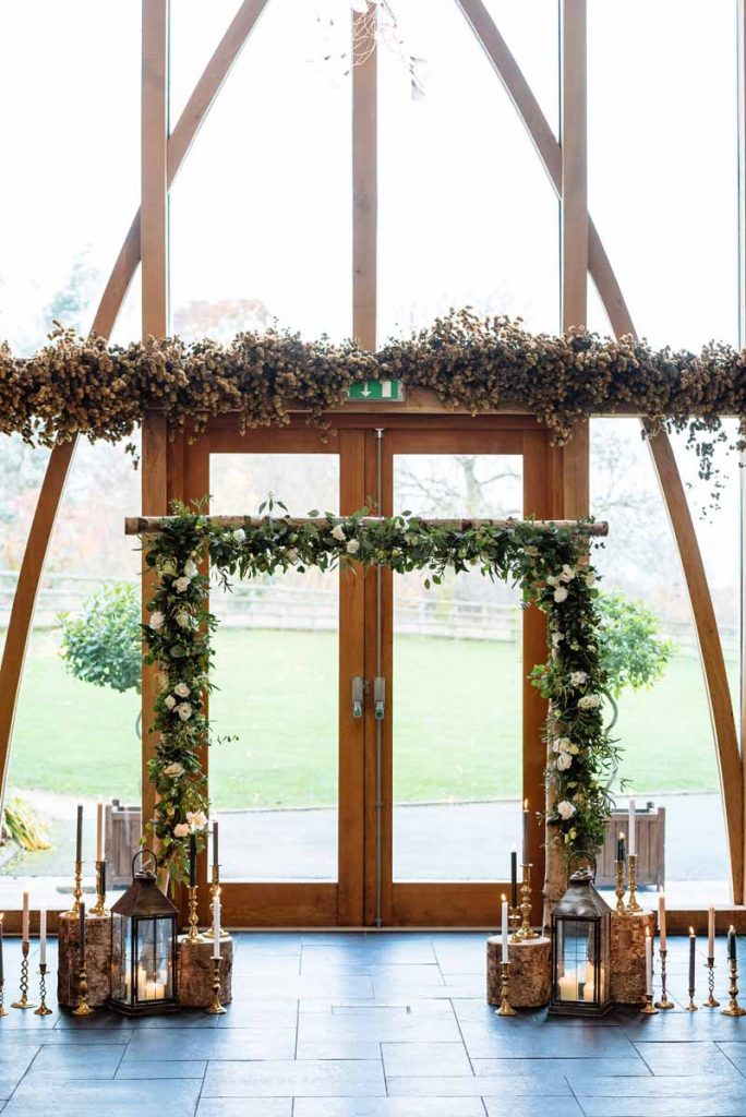 Birch-arch-arbour-rustic-wedding-ceremony-Mythe-Barn