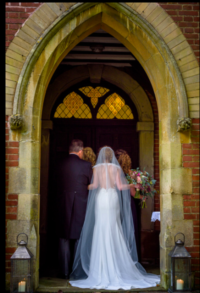 Bride entering Barston Church