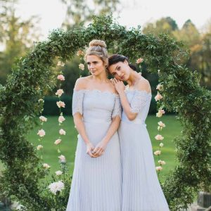 Coast bridesmaids dresses round wedding moongate arch by Passion for Flowers