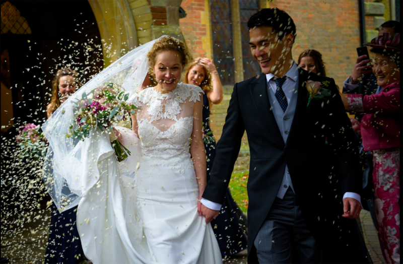 Confetti throwing outside Barston Church bouquet by Passion for Flowers