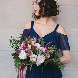 Deep pink purple flowers with navy blue bridesmaids dresses Coast