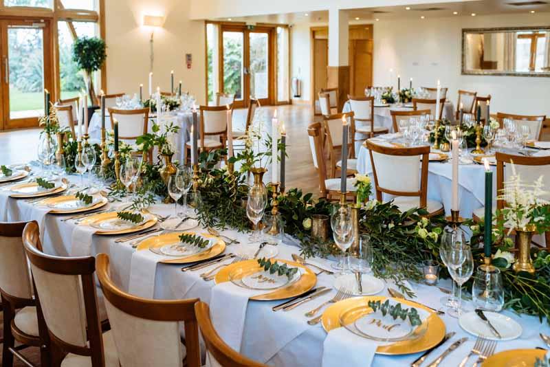 Gold-and-green-wedding-colours-top-table-by-Passion-for-Flowers