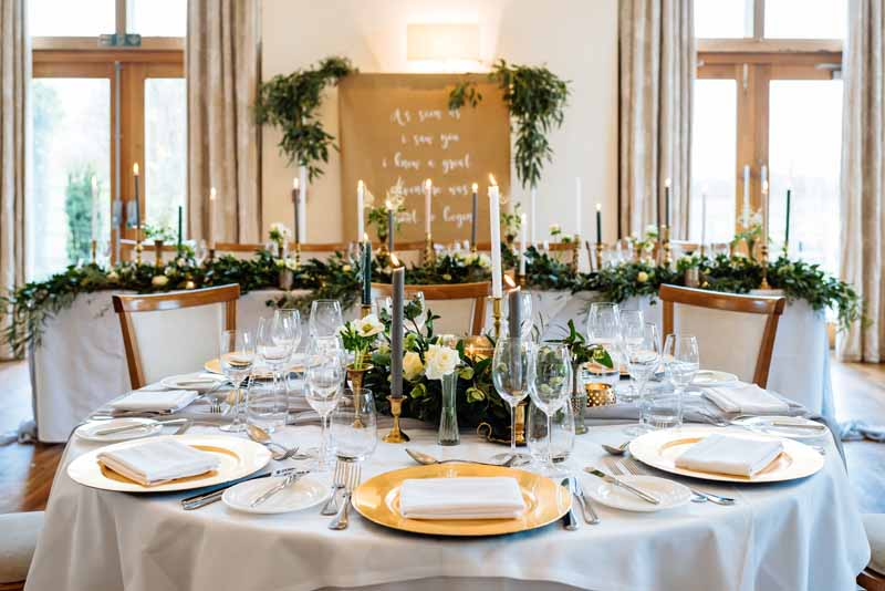 Green-and-gold-wedding-centrepieces-low-Mythe-Barn-venue-Passion-for-Flower