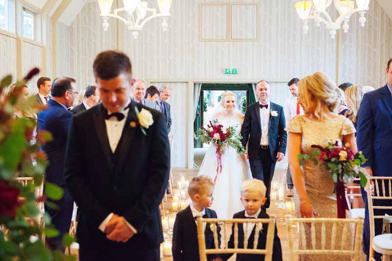 Hampton Manor wedding ceremony bride walking down the aisle to her children and groom Hampton Manor by Passion for Flowers