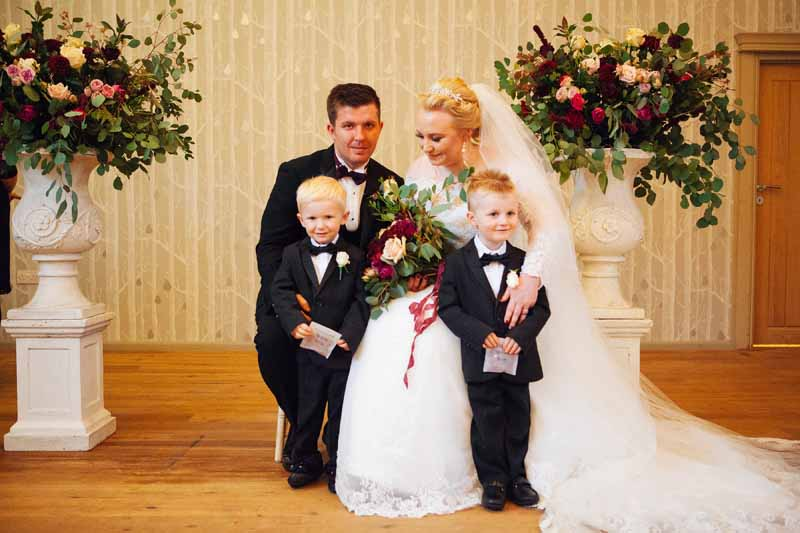 Large stone urns wedding ceremony Hampton Manor by Passion for Flowers