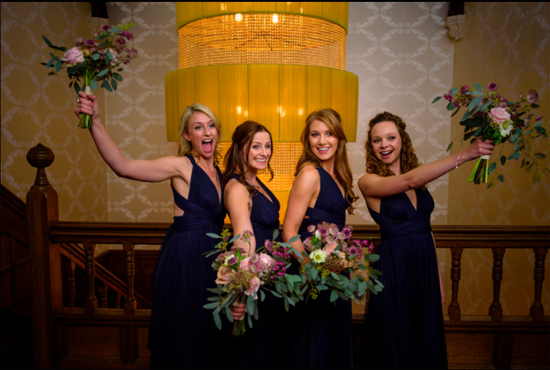 Navy two birds bridesmaids dresses autumn bridesmaids bouquets organic natural style by Passion for Flowers at Hampton Manor