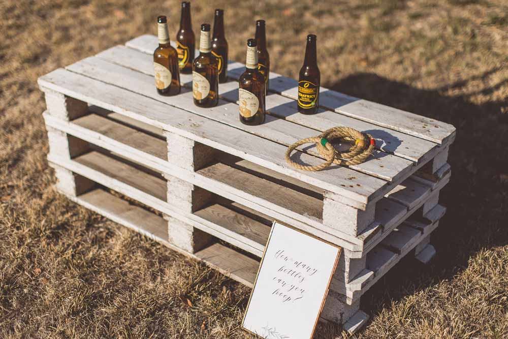 Garden games toss the hoops over the beer bottles - Destination wedding Tuscany
