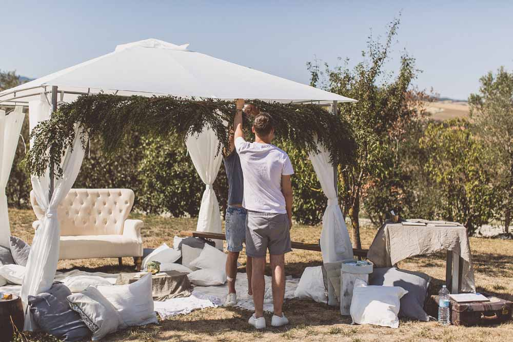 Rustic Hilltop Wedding Flowers Tuscany Italy Passion for Flowers Destination Wedding - Relaxed Gazebo Tent Shade Preparations Locanda In Tuscany Karen Morgan Florist