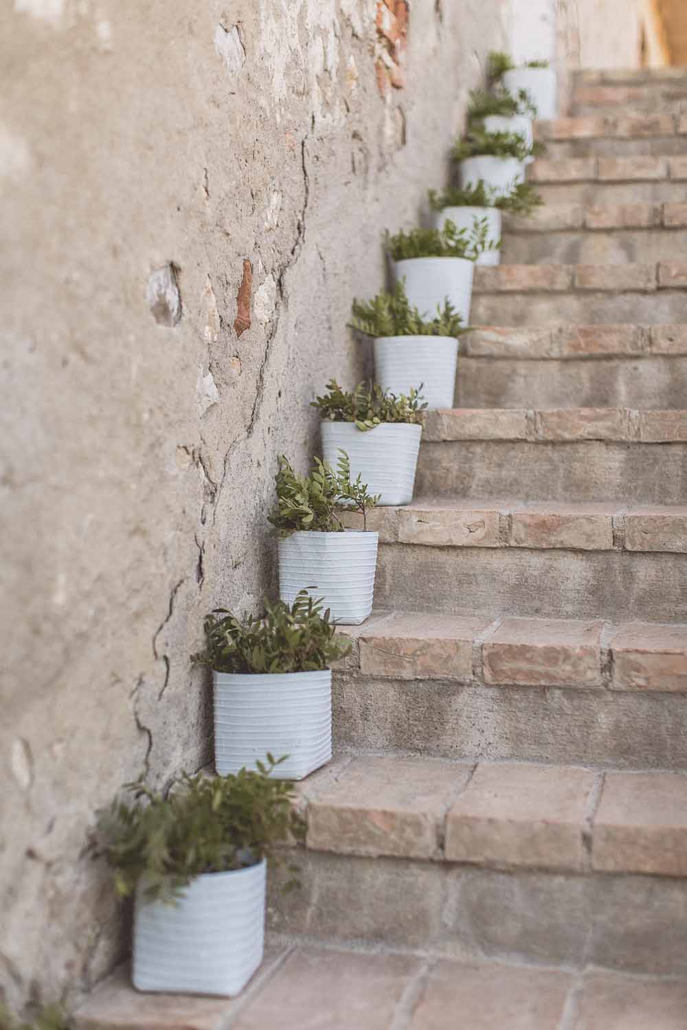 Staircase decoration herbs up outdoor steps destination wedding Locanda in Tuscany, Passion for Flowers