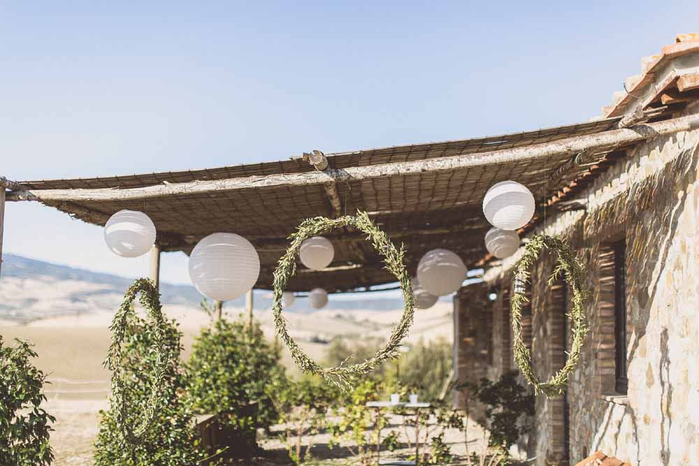Rustic Hilltop Wedding in Tuscany Hanging Flower Foliage Hoops Paper Lanterns Passion for Flowers - Locanda In Tuscany