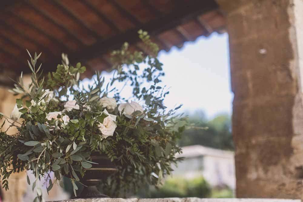 Outdoor wedding ceremony table floral display rustic glamour Tuscany