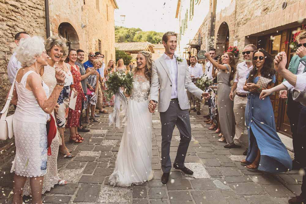 Destination wedding Tuscany confetti tunnel in the streets of Bagno Vignoni