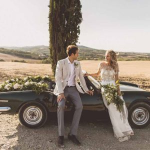 Anna Campbell Adelaide Wedding Gown, Couple portraits Destination wedding Tuscany, Wedding Car Garlands