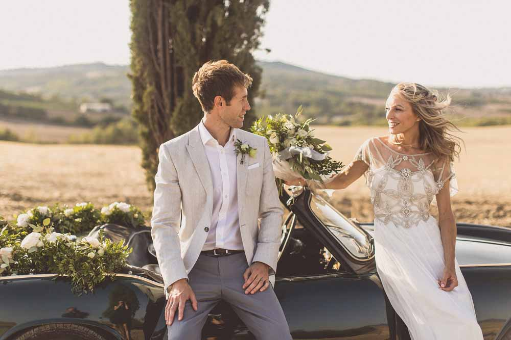 Anna Campbell Adelaide Wedding Gown, Couple portraits Destination wedding Tuscany, Wedding Car Floral Garlands