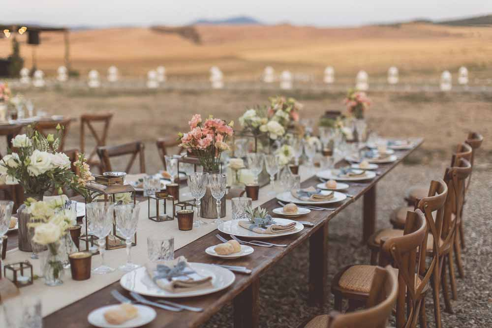 Rustic Hilltop Italian Wedding, Long wooden wedding guest tables outside Tuscany - Florals by Passion for Flowers, Lanterns & Decor The Wedding of my Dreams Venue Locanda In Tuscany