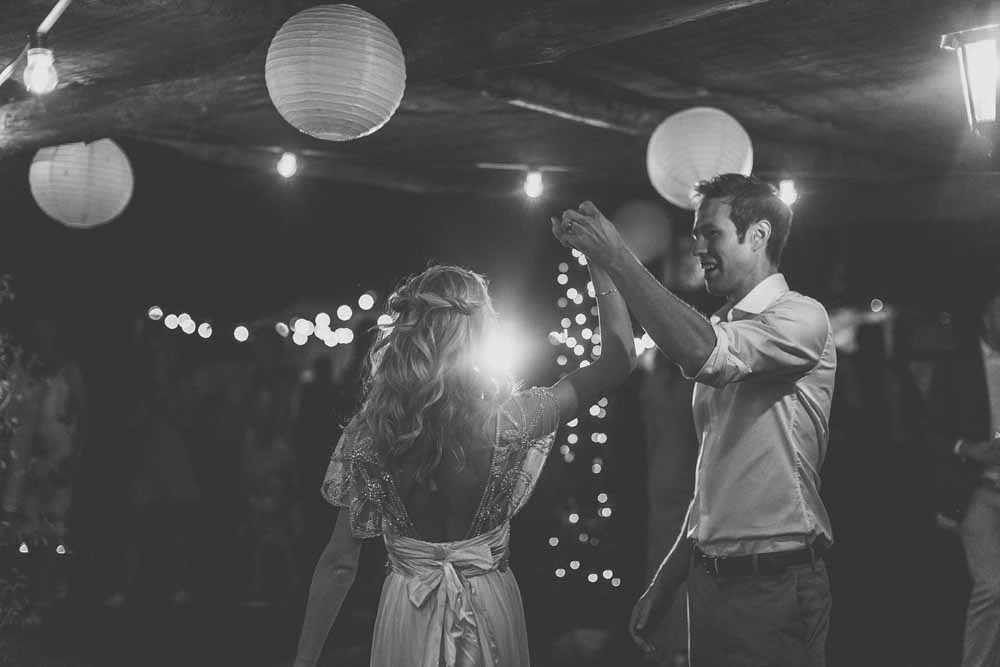 Outdoor wedding dance floor hanging paper lanterns strings of festival lights destination wedding Tuscany - venue Locanda In Tuscany