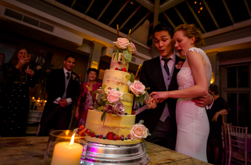 Cake cutting at Hampton Manor wedding