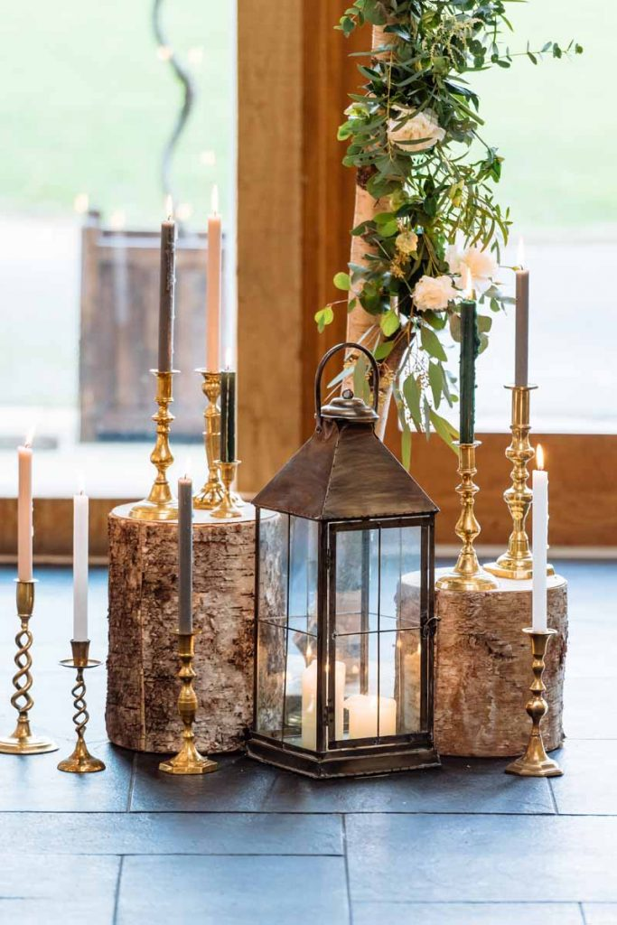 Tree-stumps-and-gold-candlestciks-rustic-glamour-wedding-ceremony-styling.