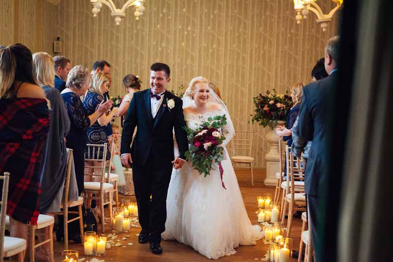 Wedding ceremony aisle decoration cylinder vase lanterns and petals at Hampton Manor by Passion for Flowers