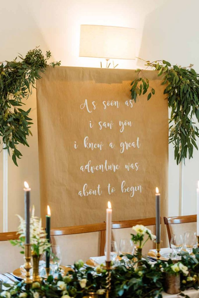 wedding-backdrop-ideas-brown-paper-and-calligraphy-quote