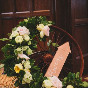 Alternative wreath floral garland on cart wagon wheel Hampton Manor Wedding Florist Passion for Flowers