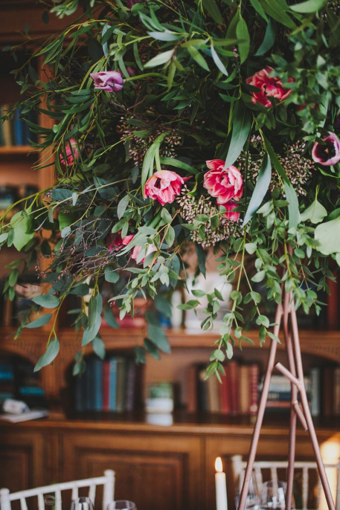 Rustic wedding centrepieces tall branch stand with organic flowers Hampton Manor Wedding Florist Passion for Flowers