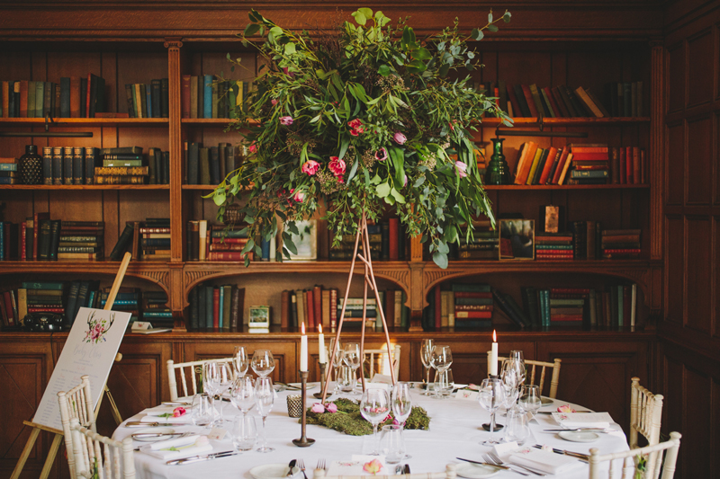 Rustic wedding centrepieces tall branch stands with organic flowers Hampton Manor Wedding Florist Passion for Flowers