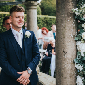 Birtsmorton Court outdoor wedding ceremony groom Arch of flowers