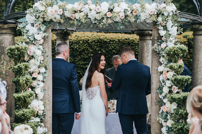 Ceremony arch by Passion for Flwers outdoor wedding ceremony