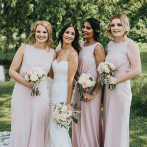Elegant bride and bridesmaids blush pink dresses