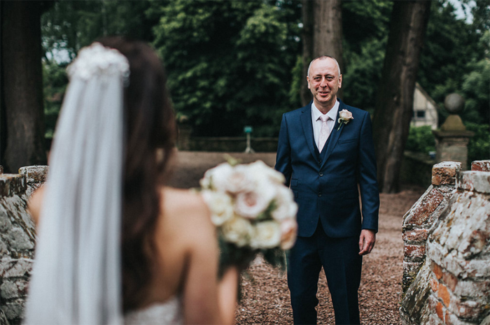First look bride and her father Birtsmorton Court Passion for Flowers