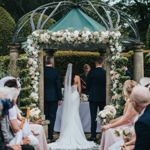 Large rose flower arch outdoor wedding ceremony Birtsmorton Court Passion for Flowers
