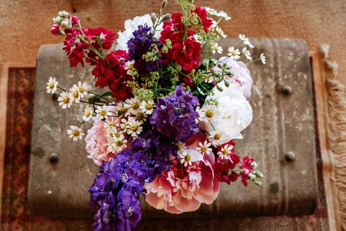 Festival wedding flowers centrepieces summer wedding in Tipi - florist: Passion for Flowers