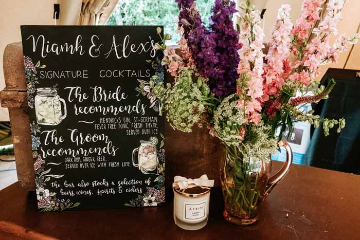 Barn menu blackboard sign with flowers by Passion for Flowers - tipi festival wedding