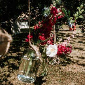 Hanging macrame bottle jars tipi wedding festival theme - florist Passion for Flowers