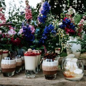 Add floral touches to your dessert table for a rustic festival wedding - florist: Passion for Flowers, tipi wedding ideas
