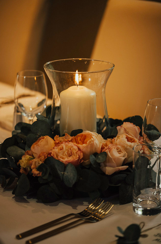 Low wedding centrepieces luxury roses with candle in centre country pub wedding venue Passion for Flowers wedding florists Solihull