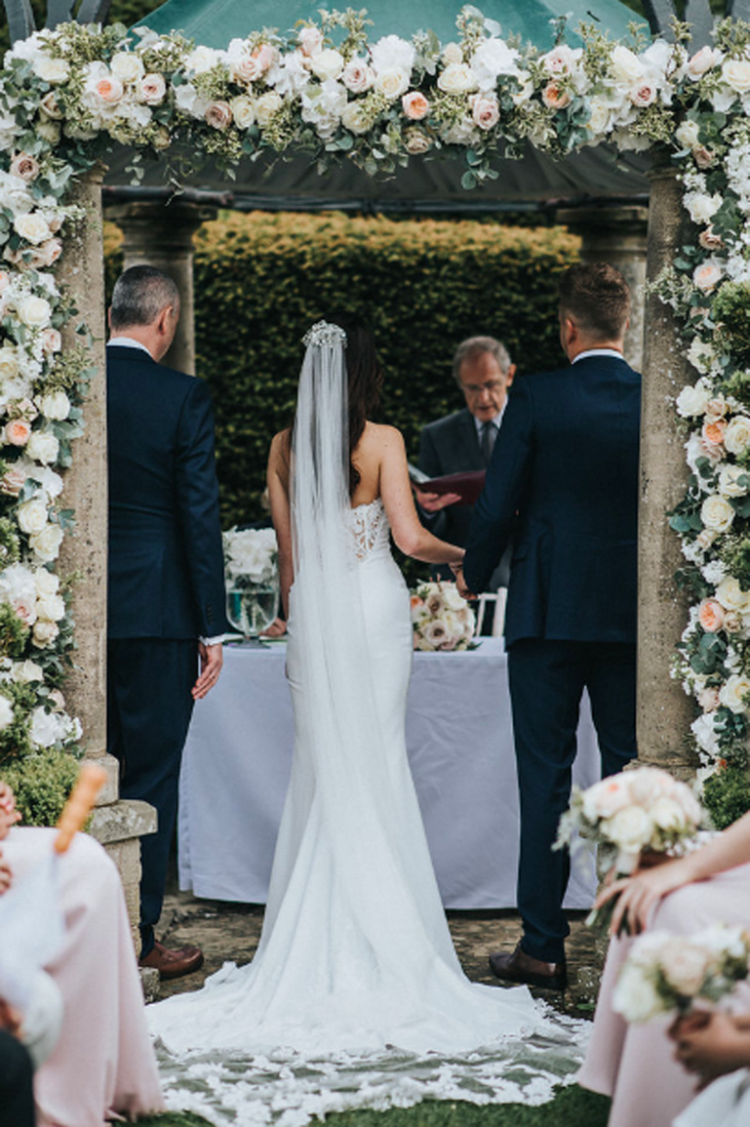 Rose arch intimate outdoor wedding ceremony Passion for Flowers