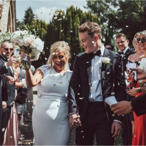 White hydrangea rose ivy trailing bridal bouquet confetti photos wedding longbourn barn kineton