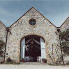 longbourn barn kineton wedding venue white ceiling drapes French barn venue UK