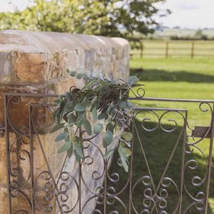 Barn wedding welcome gate flowers Passion for Flowers