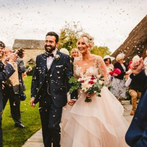 Blackwell Grange rustic barn wedding ceremony confetti shot